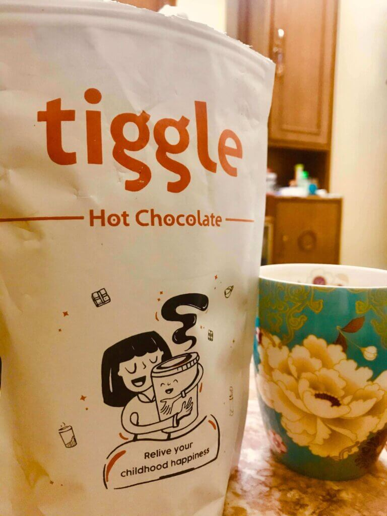 Tiggle - Hot chocolate. It will help you feel happy and you will smile.